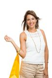 Happy Woman Raising Colored Shopping Bag Royalty Free Stock Image