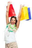 Happy Woman Raising Colored Shopping Bag Stock Images