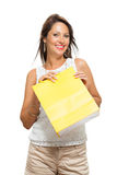 Happy Woman Raising Colored Shopping Bag Stock Photo