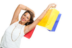 Happy Woman Raising Colored Shopping Bag Royalty Free Stock Photo