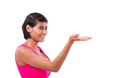 Happy woman raising her hand to show or present something Stock Photography