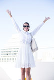 Happy woman raising her hands up Stock Photography