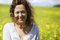 Happy woman in rapeseed field stock photos