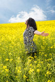 Happy woman in rapeseed field Stock Images