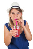 Happy woman with raspberry mint lemonade. Picture of a beautiful young woman holding a raspberry mint lemonade posing on isolated background on summertime Royalty Free Stock Photo