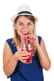 Happy woman with raspberry mint lemonade. Picture of a beautiful young woman holding a raspberry mint lemonade posing on isolated background on summertime Royalty Free Stock Images