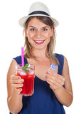 Happy woman with raspberry mint lemonade and sunglasses. Picture of a beautiful female tourist holding a raspberry mint lemonade and greece flag posing on Stock Photos
