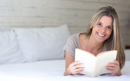 Happy woman reading a book Stock Image