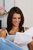 Happy woman reading a card stock image