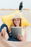 Happy Woman Reading EBook In Hammock Stock Image