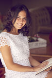 Happy woman reading. At home Stock Photography