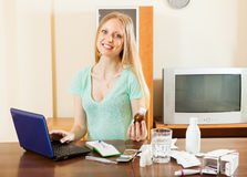 Happy  woman reading about medications in internet Stock Photography