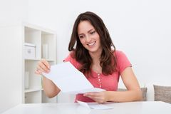 Happy woman reading paper Stock Image