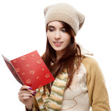 Happy woman reading red postcard Royalty Free Stock Photo