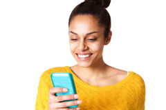 Happy woman reading text message on mobile phone Royalty Free Stock Photography