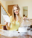 Happy woman reading user manual for  steamer Stock Image