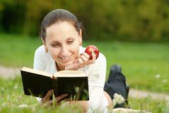Happy woman reads book Royalty Free Stock Photo
