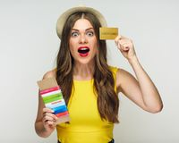 Happy woman ready for holiday with passport, ticket, credit card. Isolated portrait Stock Photos