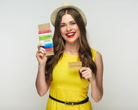 Happy woman ready for holiday with passport, ticket, credit card. Isolated portrait Royalty Free Stock Image