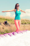 Happy woman ready to take off with a paraglider Stock Photography