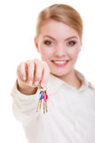 Happy woman real estate agent holding set of keys to new house. Or car. Property business and accomodation or home buying ownership concept, isolated on white Royalty Free Stock Photos