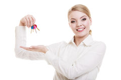 Happy woman real estate agent holding set of keys to new house Stock Photo