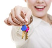Happy woman real estate agent holding set of keys to new house. Or car. Property business and accomodation or home buying ownership concept, isolated on white Royalty Free Stock Photography