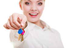 Happy woman real estate agent holding set of keys to new house. Or car. Property business and accomodation or home buying ownership concept, isolated on white Royalty Free Stock Image