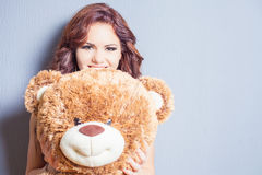 Happy woman received a teddy bear at celebration Stock Photo