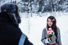 Happy woman receives flowers as a gift from man Royalty Free Stock Photography