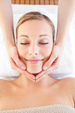 Happy woman receiving a head massage Royalty Free Stock Photo