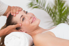 Happy woman receiving neck massage Royalty Free Stock Image