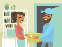 Happy woman receiving package from courier. At home e-commerce concept Royalty Free Stock Photo