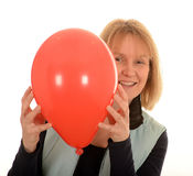 Happy woman with red balloon Royalty Free Stock Photography