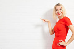 Happy woman in red dress Royalty Free Stock Photography