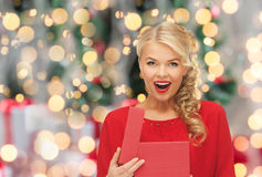 Happy woman in red dress with christmas gift box Royalty Free Stock Images