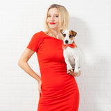 Happy woman in red dress with dog Royalty Free Stock Photography