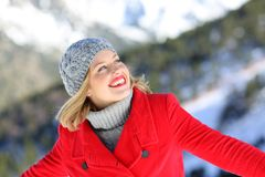 Happy woman enjoying winter holiday. Happy woman in red enjoying winter holiday in the mountain stock images