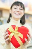 Happy woman and red gift box Stock Images