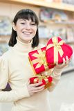 Happy woman and red gift box Stock Photos