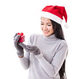 Happy woman with red gift box and christmas hat Royalty Free Stock Images