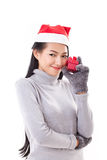 Happy woman with red gift box and christmas santa hat Stock Photos
