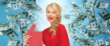 Happy woman in red with gifts over money rain Royalty Free Stock Photo
