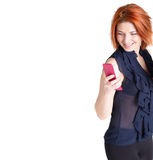 Happy woman with red hair and a telephone Stock Image