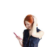 Happy woman with red hair and a telephone Stock Photography