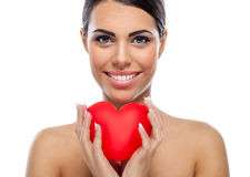 Happy woman with red hart Royalty Free Stock Photography