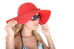 Happy woman in red hat and sunglasses Stock Photography