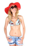 Happy woman in red hat and sunglasses Royalty Free Stock Photo