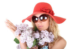 Happy woman in red hat and sunglasses with lilac Stock Photos