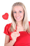 Happy woman with red heart Royalty Free Stock Photos